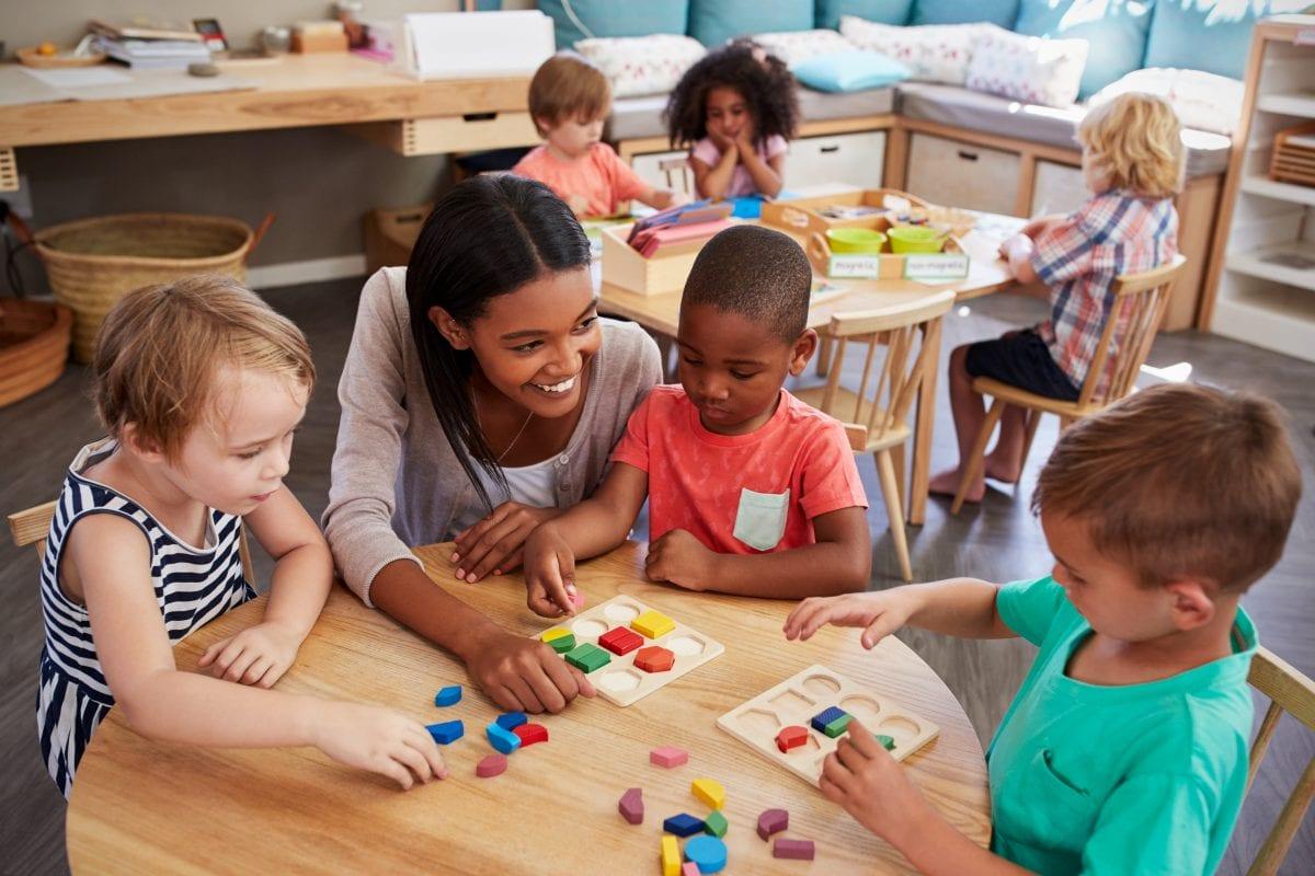 teacher with preschool children