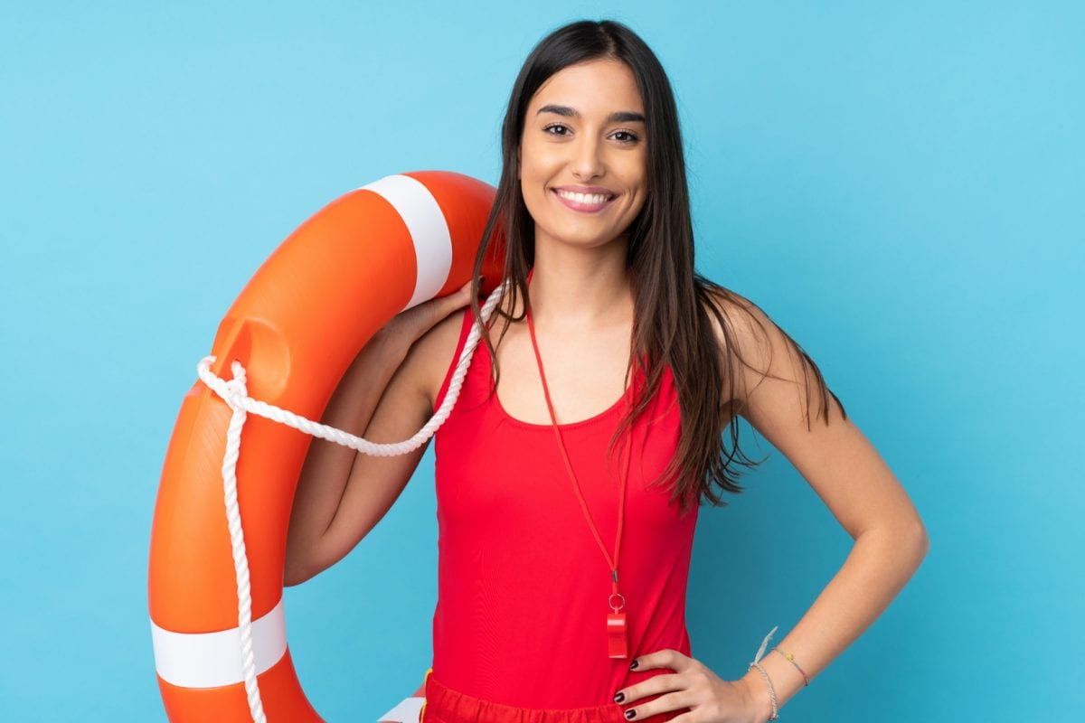 summer jobs for teenages | female lifeguard in red swimsuit